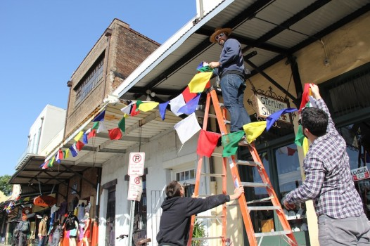 Prayer flags are going up around the city in anticipation of the Dalai Lama's visit.