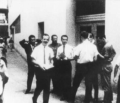 Lee Harvey Oswald distributing Fair Play for Cuba leaflets outside the original ITM, August 16, 1963. (Photo by WDSU-TV cameraman Johann Rush)