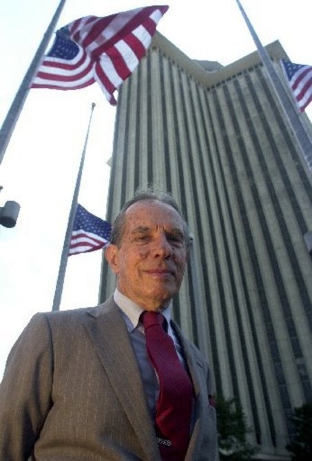 World Trade Center Association founder Paul Fabry poses defiantly in front of the WTC tower just days September 11, 2001. (Photo by G.Andrew Boyd, nola.com)