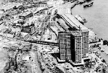 WTC tower under construction, showing undeveloped surroundings in the 1960s.