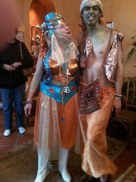 Get costume ready, like this Harem couple at Krewe du Vieux 2012, before the parade at King Pin.