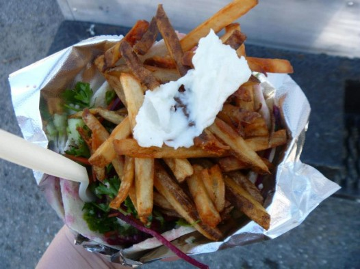 The Fat Falafel tops their fries with dollops of toum.