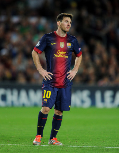 The Qatar Foundation logo is prominently displayed across the jersey of FC Barcelona player Lionel Messi