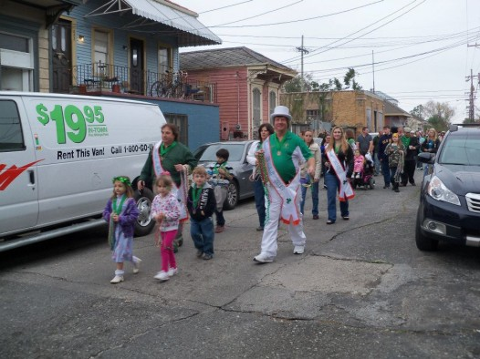 The Downtown Irish Club leads a pre-St. Patrick's Day parade on Sunday.