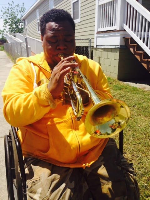 Terrell Batiste plays his trumpet in front of his new Habitat for Humanity house in the Upper 9th Ward.