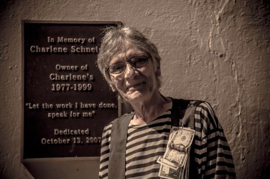 Dianne Schneider next to a plaque honoring her sister, Charlene. Credit: Melisa Cardona