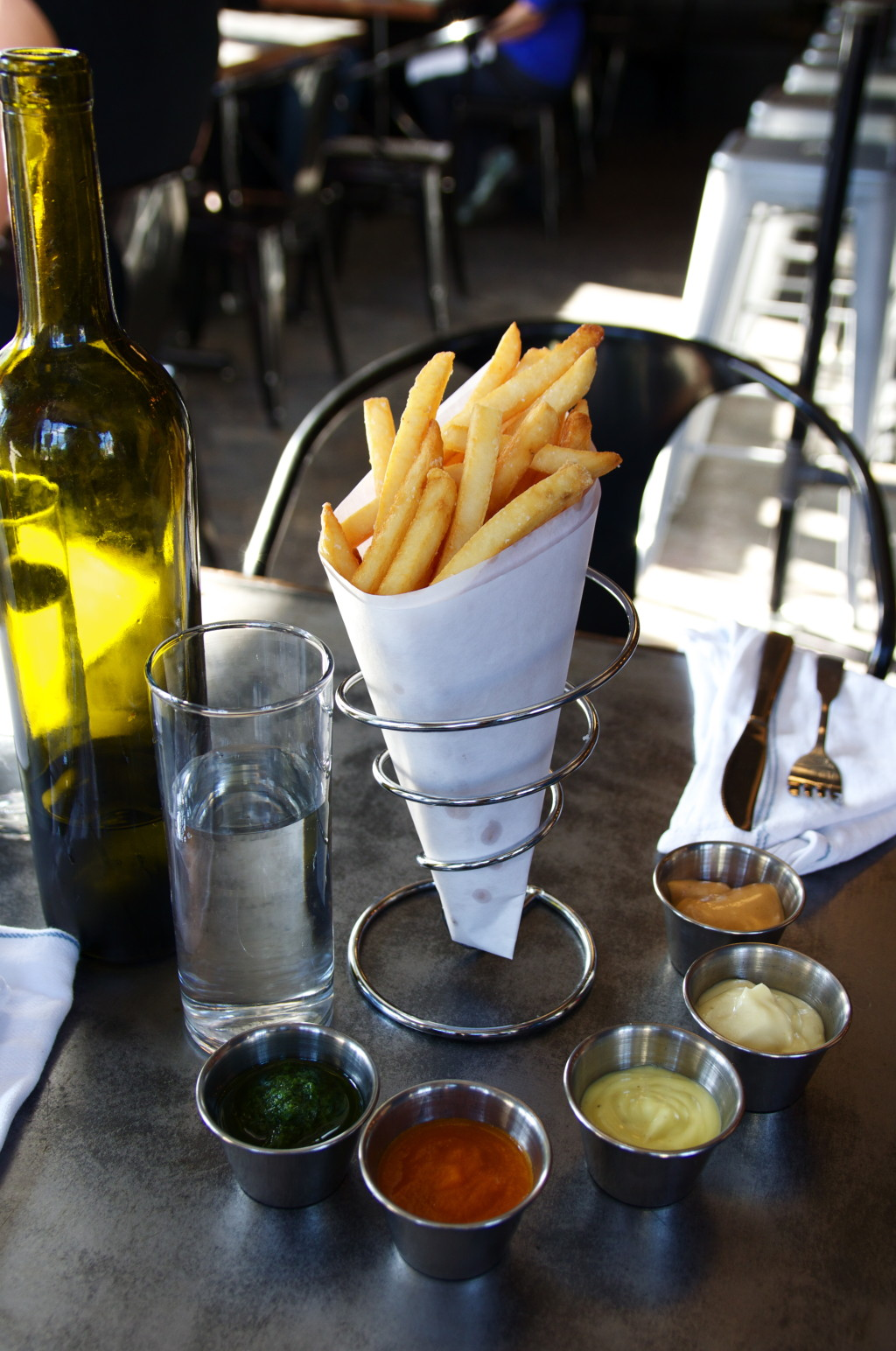 """Belgian """"frites"""" at Booty's Street Food feature a quintet of dipping options."""