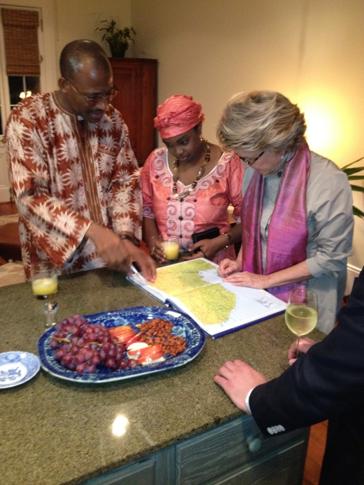 A NODC member with two visitors from Africa at a home hospitality meal, at which members host international visitors in their homes for dinner. Photo: NODC