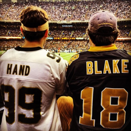 Saints jersey statements back in 2000: wearing defensive tackle Norman Hand and quarterback Jeff Blake.