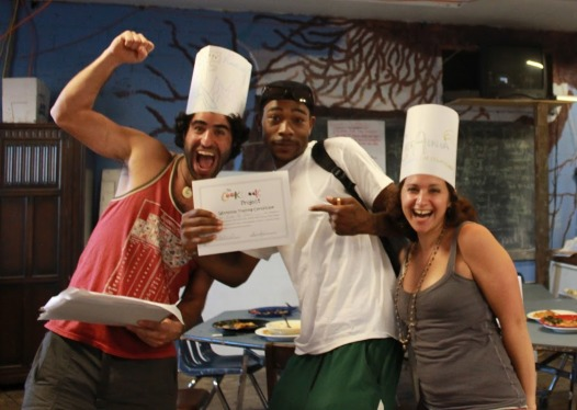 Adam Aronovitz, left, and Alissa Bilfield, right, celebrate with a happy workshop graduate.