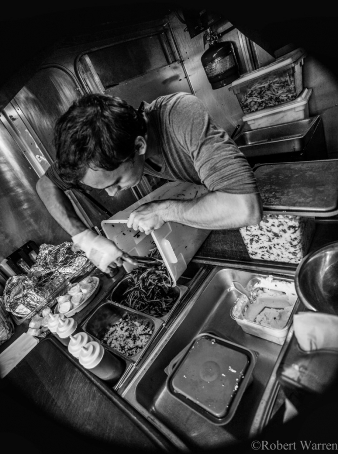 Fat Falafel and 1000 Figs co-founder Gavin Cady at work inside the Fat Falafel truck. (Photo: Robert Warren)