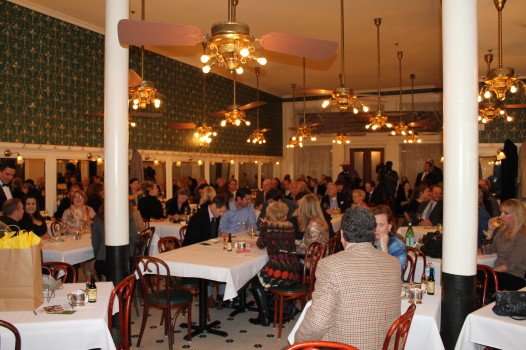 Monday night, crowds bid on reserved tables at Galatoire's for Lundi Gras. (Photo: Caitlin Switzer/The Ehrhardt Group)