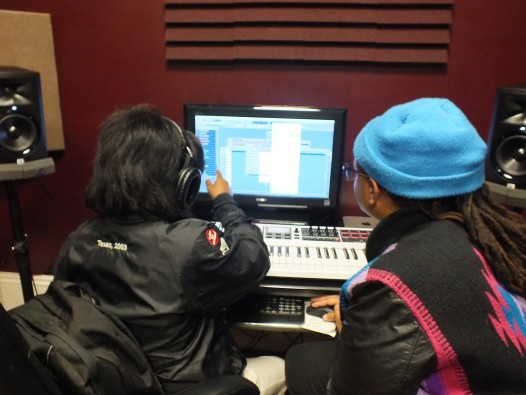 AF THE NAYSAYER works with a student at Upbeat Academy