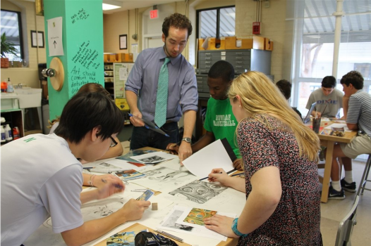 Dean of the Arts Andrew Rodgers, center, works with Isidore Newman students.
