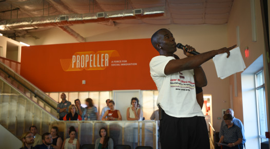 Lower Ninth Ward Market co-founder Burnell Cotlon pitching on stage at Propeller's PitchNOLA: Living Well competition. (photo: Chet Overall)