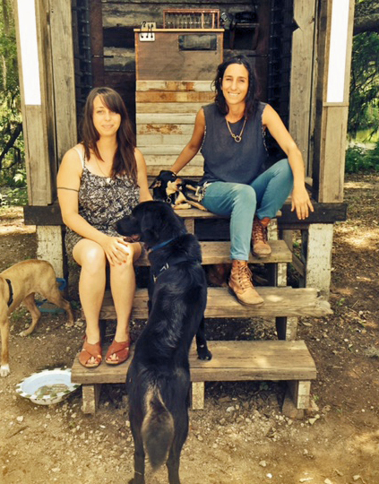 Airlift's Tori Bush and Delaney Martin hang out with four-footed friends in Shake House, by Martin and Airlift co-founder Taylor Lee Shepherd. (Photo: Renee Peck)
