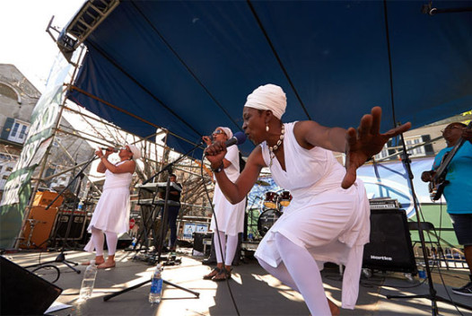 Sula Janet Evans, left, performs live at French Quarter Fest with Zion Trinity at the Old U.S. Mint.