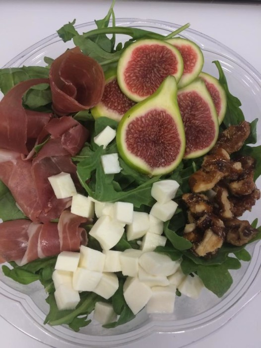 Fig, prosciutto,mozarello and candied walnut salad on a bed of arugula (Photo: Green to Go NOLA facebook)
