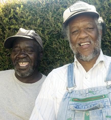One of The Cresebt City Farmer's Merket's original vendors, Ben Burkett (right).
