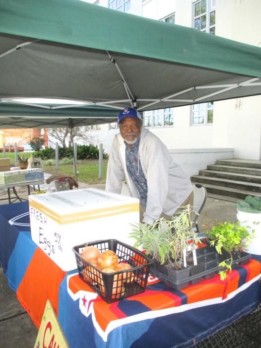 Calvin Alexander sells produce at the St. Claude Avenue farmers market.