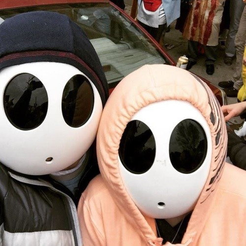 Shy Guy masks work double duty for a crowd-challenged Mardi Gras neophyte.