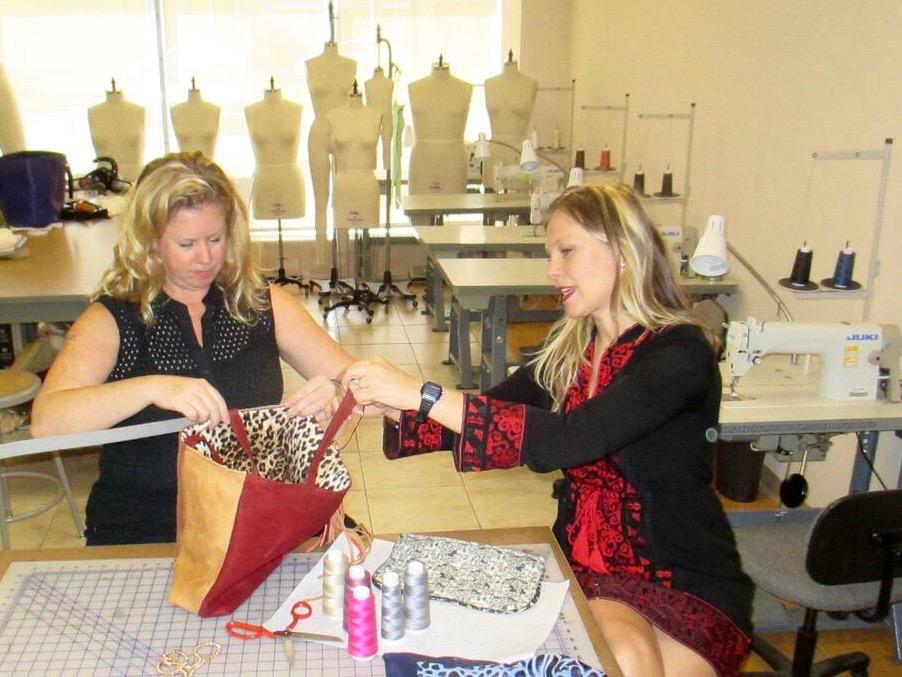 April Clark and Alison Parker measure samples for their leather handbag design class.