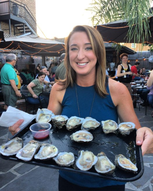 Laurie Thomasee A Happy Oyster Customer Celebrating National On The Half Shell Day With Two Girls One Shuck Photo Credit Becky Wasden