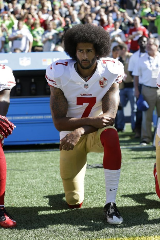 Colin Kaepernick kneeling during the National Anthem